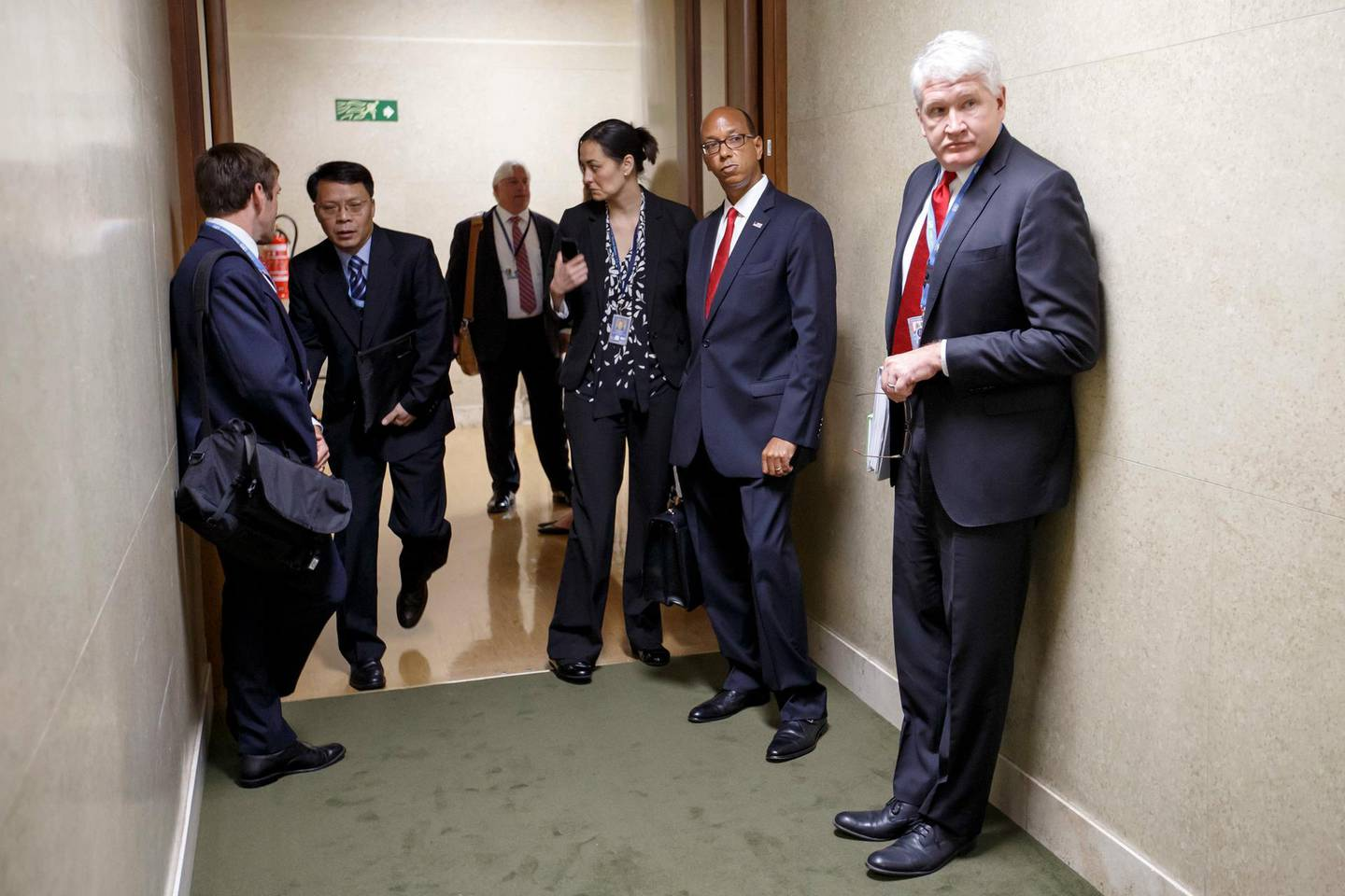 U.S. Disarmament Ambassador Robert Wood, second right, and members of delegations stand in the corridor after he left the conference in protest against Syrian presidency  at the Conference on Disarmament at the European headquarters of the United Nations in Geneva, Switzerland, Tuesday, May 29, 2018. (Salvatore Di Nolfi/Keystone via AP)