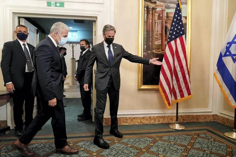 U.S. Secretary of State Antony Blinken welcomes Israeli Foreign Minister Yair Lapid for their meeting in Rome, Italy, June 27, 2021. Andrew Harnik/Pool via REUTERS