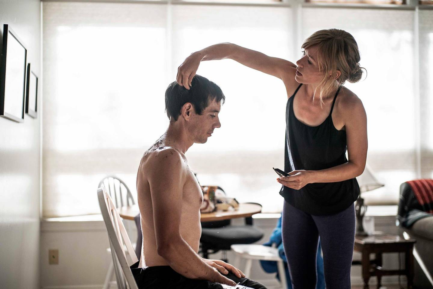 Alex Honnold getting his haircut by his girlfriend Sanni McCandless before attempting his free solo of El Cap. (National Geographic/Jimmy Chin)