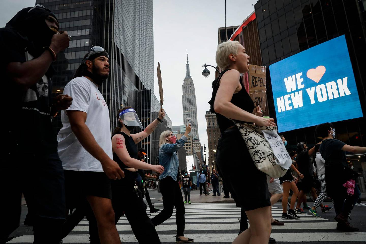 Protesters march past Madison Square Garden as the Empire State Building stands in the background, Thursday, June 4, 2020, in the Manhattan borough of New York. Protests continued following the death of George Floyd, who died after being restrained by Minneapolis police officers on May 25. (AP Photo/John Minchillo)