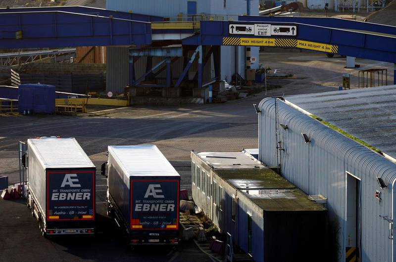 Parked lorries sit near a sign directing freight traffic arriving from Europe towards Passport Control at the Port of Ramsgate in Ramsgate, south east England on January 8, 2019. In the Port of Ramsgate, dredging is under way to prepare the harbour for use in case of delays at the Port of Dover after March 29, the date the UK is set to leave the European Union.  / AFP / Tolga Akmen / Tolga Akmen
