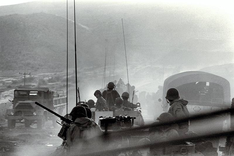 A handout file picture provided by the GPO and dated October 8, 1973 shows Israeli units moving into battle counter-attacking Syrian troops on the Golan Heights during the Yom Kippur war. / AFP PHOTO / GPO / DAVID RUBINGER