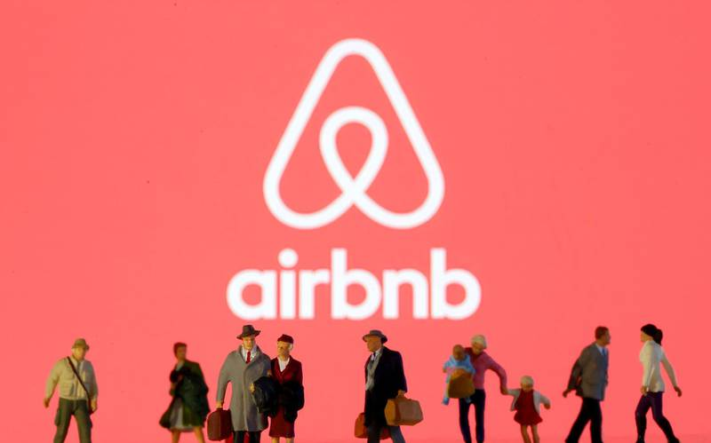 FILE PHOTO: Small toy figures are seen in front of diplayed Airbnb logo in this illustration taken March 19, 2020. REUTERS/Dado Ruvic/Illustration/File Photo