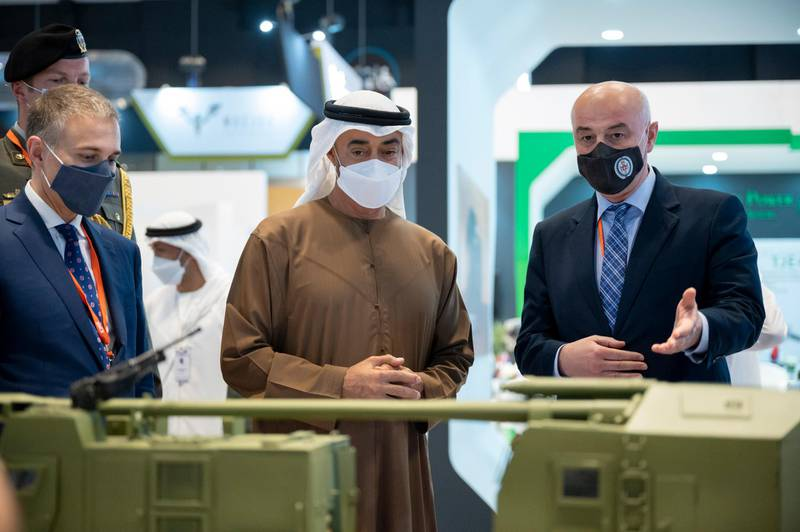 ABU DHABI, UNITED ARAB EMIRATES - February 23, 2021: HH Sheikh Mohamed bin Zayed Al Nahyan, Crown Prince of Abu Dhabi and Deputy Supreme Commander of the UAE Armed Forces (C) tours the International Defence Exhibition and Conference 2021 (IDEX), at ADNEC.  ( Rashed Al Mansoori / Ministry of Presidential Affairs ) ---