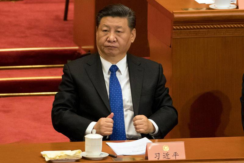 In this Saturday, March 3, 2018, photo, Chinese President Xi Jinping attends the opening session of the Chinese People's Political Consultative Conference in Beijing's Great Hall of the People. Xi is poised to make a historic power grab as China's legislators gather from Monday and prepare to approve changes that will let him rule indefinitely and undo decades of efforts to prevent a return to crushing dictatorship. (AP Photo/Ng Han Guan)
