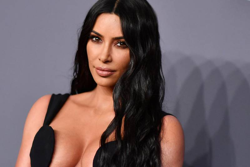 (FILES) In this file photo taken on February 06, 2019, US media personality Kim Kardashian West arrives to attend the amfAR Gala New York. Reality television star, influencer and business owner Kim Kardashian West is officially a billionaire, according to an estimate from Forbes, making her debut on the exclusive global list only one year after her younger sister Kylie Jenner fell off of it.  Kardashian West's money comes from TV income and endorsement deals, according to the magazine, as well as her two lifestyle brands.  / AFP / ANGELA  WEISS