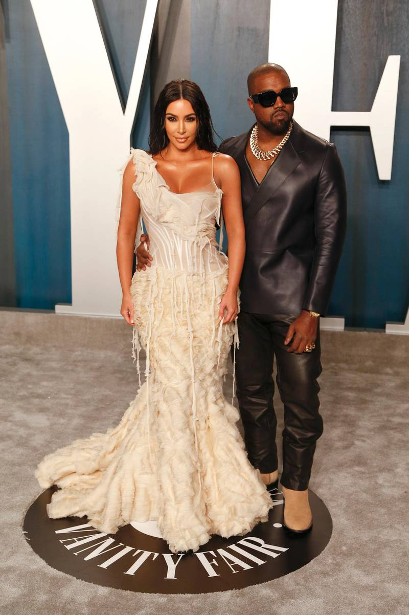 epa08208661 Kim Kardashian and husband, US rapper Kanye West (R), attendattend the 2020 Vanity Fair Oscar Party following the 92nd annual Academy Awards ceremony, in Beverly Hills, California, USA, 09 February 2020. The Oscars were presented for outstanding individual or collective efforts in filmmaking in 24 categories.  EPA-EFE/RINGO CHIU