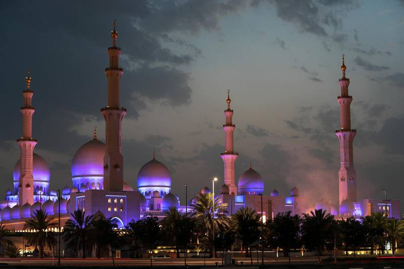 Abu Dhabi, UAE.  May 16, 2018.  Waiting for the moon to come out at the Sheikh Zayed Mosque.  Smoke from the canons fired to mark the first moon sighting.  (bottom right)Victor Besa / The NationalSection:  National