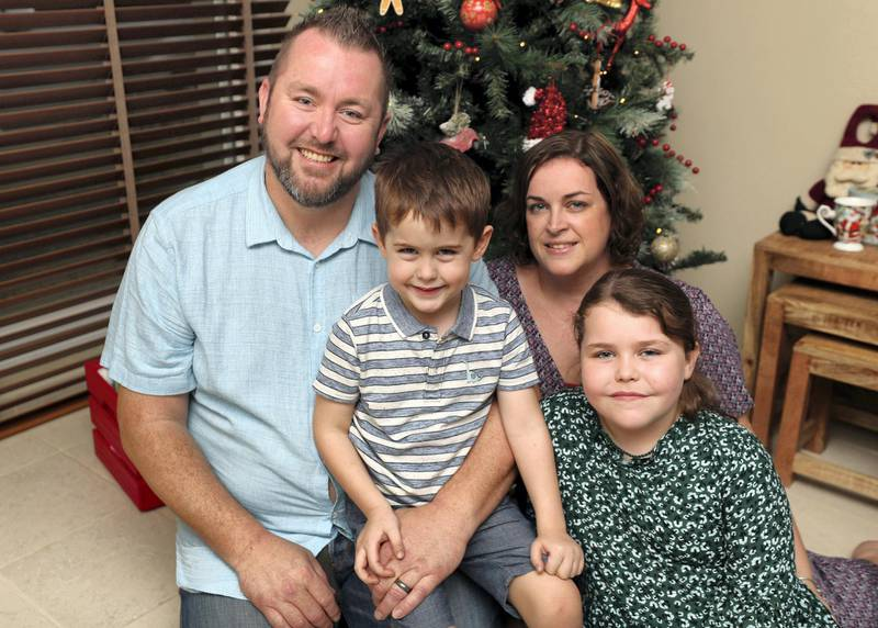 Dubai, United Arab Emirates - December 10, 2020: Chris Bradwell is the owner/admin of British Dads Dubai. He is one of a few voices in a story about Christmas spending for the personal finance page. Pictured with wife Stacey, son Thomas 4 and daughter Izzy 10. Thursday, December 10th, 2020 in Dubai. Chris Whiteoak / The National