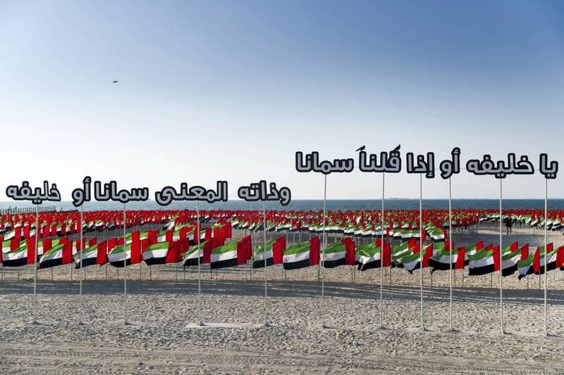 DUBAI, UNITED ARAB EMIRATES - NOVEMBER 29, 2018. A poem in praise of Sheikh Khalifah at Flag Garden on Kite Beach.(Photo by Reem Mohammed/The National)Reporter: Section:  NA POAN