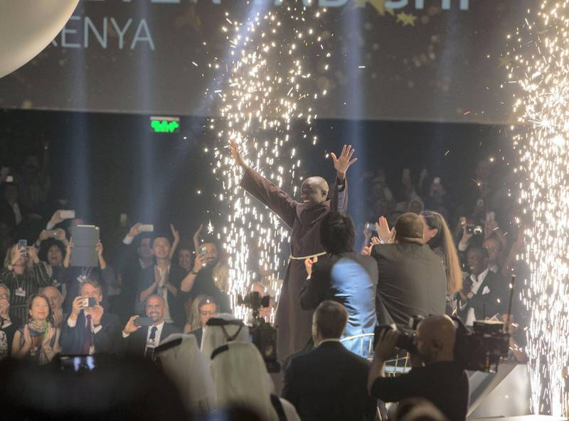 DUBAI, UNITED ARAB EMIRATES - Winner of the Global Teacher Prize 2019 Peter Tabichi from Kenya with after announcing he is the winner at the Global Education and Skills Forum 2019 at Atlantis, The Palm.  Leslie Pableo for The National for Anam Rizvi's shorty