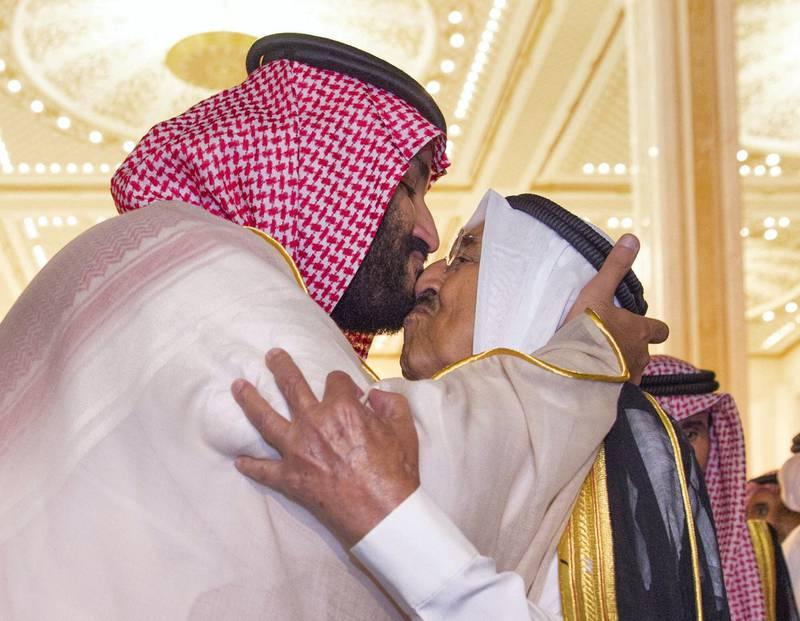 Kuwaiti Emir Sheikh Sabah al-Ahmad al-Jaber al-Sabah greets the Saudi Crown Prince Mohammed bin Salman in Kuwait September 30, 2018. Picture taken September 30, 2018.  Bandar Algaloud/Courtesy of Saudi Royal Court/Handout via REUTERS ATTENTION EDITORS - THIS PICTURE WAS PROVIDED BY A THIRD PARTY.