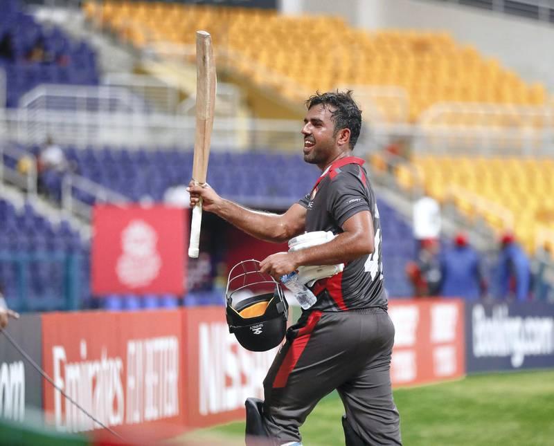 Abu Dhabi, United Arab Emirates, October 27, 2019.  T20 UAE v Canada-AUH--- Mohammad Usman of the UAE team raises his bat to the crowd.Victor Besa/The NationalSection:  SPReporter:  Paul Radley