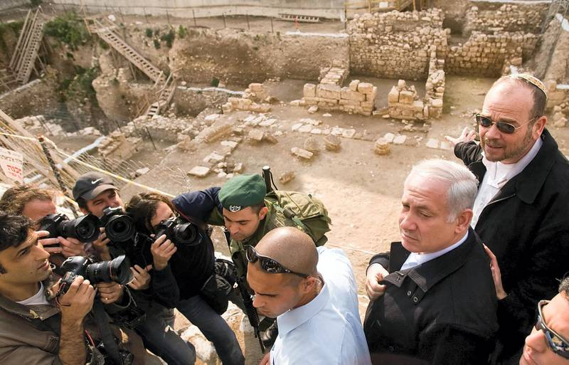 """Likud Party leader Benjamin Netanyahu visits an archeological site just outside the walls of the Old City in Jerusalem, on February 02, 2009. Voters are being asked to choose between a candidate without """"calibre"""" and a rival that """"you can't trust"""" as Israel's main parties wage a mud-slinging election campaign in the shadow of the Gaza war. With just nine days to go before the general election, right-wing Likud leader and former premier Benjamin Netanyahu is stepping up the battle with Foreign Minister Tzipi Livni of the centrist party Kadima. AFP PHOTO/Leon Neal (Photo by LEON NEAL / AFP)"""
