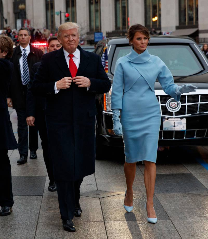 epa05736800 US President Donald J. Trump (L) walks with first lady Melania Trump (R) during the Inaugural Parade after he was sworn in as the 45th President of the United States in Washington, DC, USA, 20 January 2017. Trump won the 08 November 2016 election to become the next US President.  EPA/EVAN VUCCI / POOL