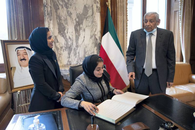 LONDON 1st October 2020. Rua AlZadjali (centre) and Amal Ali from the Oman Embassy in London sign a book of condolence at the Kuwait Embassy in London with the Kuwait Ambassador Khaled Al-Duwaisan (right)  following the death of the Emir of Kuwait. Stephen Lock for the National