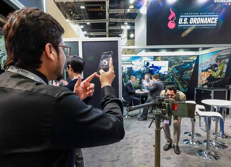 Abu Dhabi, U.A.E., February 18, 2019. INTERNATIONAL DEFENCE EXHIBITION AND CONFERENCE  2019 (IDEX) Day 2--  Exhibition visitors check out a 30mm machine gun system.rVictor Besa/The National