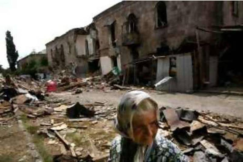 GORI, GEORGIA - AUGUST 21: A Georgian woman looks on in front of bombed buildings, August 21, 2008 in Gori, Georgia. (Photo by Uriel Sinai/Getty Images) *** Local Caption ***  GYI0055535147.jpg