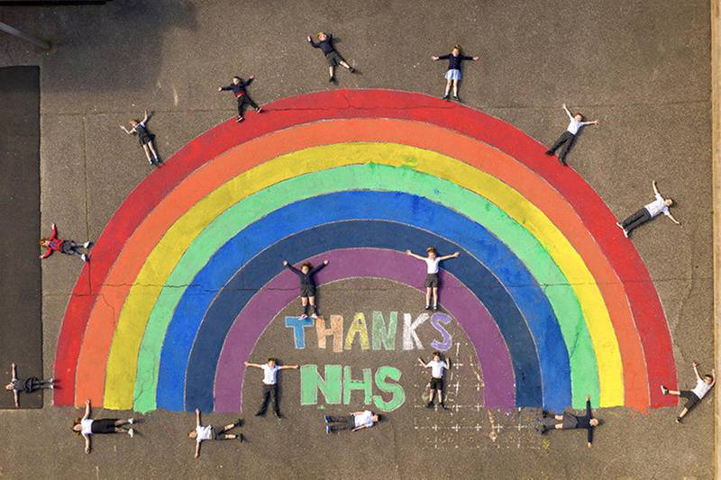 he children of keyworkers at Sheringham Primary School, Norfolk created this huge rainbow for the NHS on their playground. Some of the children's parents are nurses who have been working on the Covid ward at the Norfolk & Norwich University Hospital by CHRIS TAYLOR