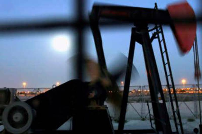 An oil pump works in the moonlight Wednesday, Nov. 12, 2008, in the oilfields of Sakhir, Bahrain, in the Persian Gulf. Oil prices dropped below $57 a barrel Wednesday on fears of stagnating global growth. Oil prices have plunged more than 60 percent in four months despite two recent OPEC production cuts. (AP Photo/Hasan Jamali) *** Local Caption ***  XHJ101_Mideast_Bahrain_Oil_Prices.jpg