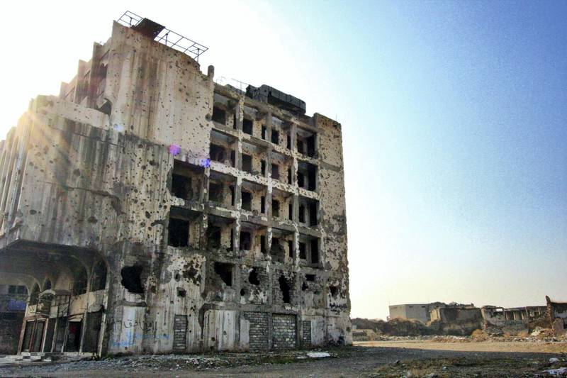 IRAQ-MOSUL_S TWO GOVERNORS-PICTURED-Pockmarked and crumbling buildings are a powerful reminder of the suffering endured by the city during the battle against ISIS. Charlie Faulkner for The National