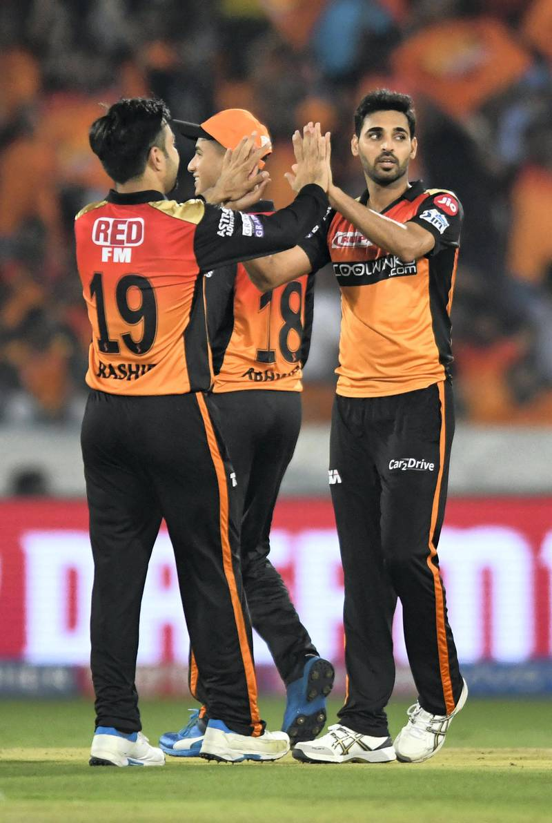 Sunrisers Hyderabad cricketer Bhuvneshwar Kumar (R) celebrates with his teammates for the wicket of Delhi Capitals batsman Shreyas Iyer (unseen) during the 2019 Indian Premier League (IPL) Twenty20 cricket match between Sunrisers Hyderabad and Delhi Capitals at the Rajiv Gandhi International Cricket Stadium in Hyderabad on April 14, 2019. (Photo by NOAH SEELAM / AFP) / ----IMAGE RESTRICTED TO EDITORIAL USE - STRICTLY NO COMMERCIAL USE-----