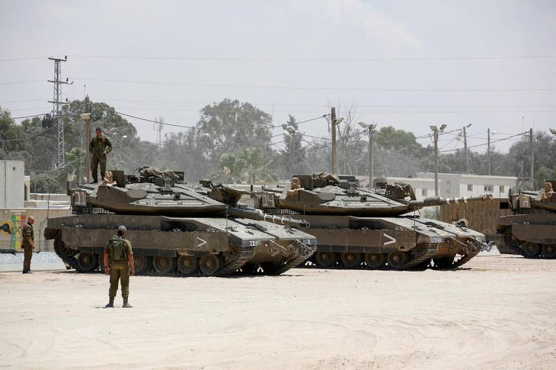 epa06773790 Israeli soldiers on tanks are stationed few kilometers from the border with Gaza, in southern Israel, 30 May 2018. Reports state the Israeli military said Palestinian militants in Gaza on 29 May fired more than 100 projectiles and rockets into Israel. The Israeli forces responded by attacking 25 military targets in Gaza.  EPA/ABIR SULTAN