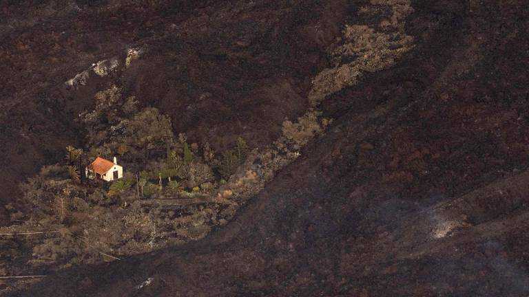 An image that illustrates this article Drone footage captures La Palma house spared lava flow