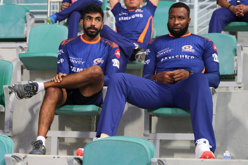 Jasprit Bumrah of Mumbai Indians and Kieron Pollard of Mumbai Indians during match 5 of season 13 of the dream 11 of Indian Premier League (IPL) between the Kolkata Knight Riders and the Mumbai Indians held at the Sheikh Zayed Stadium, Abu Dhabi  in the United Arab Emirates on the 23rd September 2020.  Photo by: Rahul Goyal  / Sportzpics for BCCI
