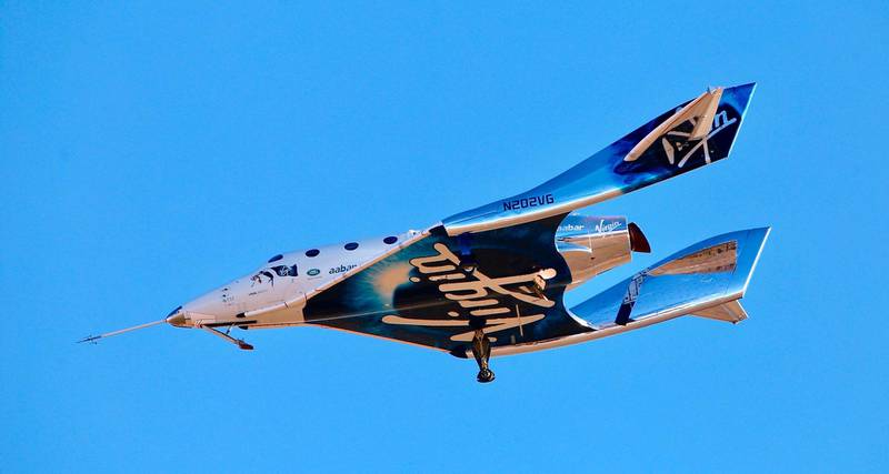FILE - In this Dec. 13, 2018 file photo, Virgin Galactic aircraftVSS Unity reaches space for the first time during its fourth powered flight from Mojave Air and Space Port, Calif. Boeing plans to invest $20 million in Virgin Galactic as the space tourism company nears its goal of launching passengers on suborbital flights. The companies announced the investment Tuesday, Oct. 8, 2019, saying they will work together on broadening commercial access to space and transforming global travel technologies. Virgin Galactic has conducted successful test flights of its winged rocket ship at Mojave, California, and is preparing to begin operations at Spaceport America in New Mexico. (AP Photo/Matt Hartman, File)