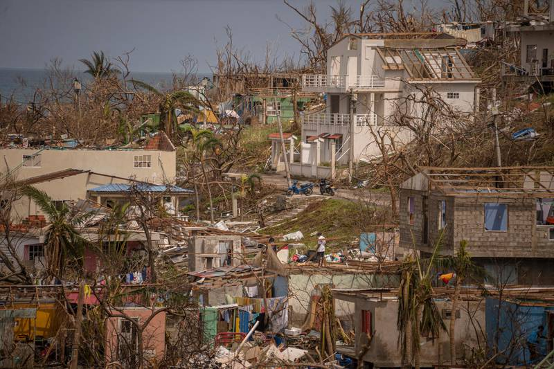 PROVIDENCIA ISLAND, COLOMBIA - NOVEMBER 21: General view of destroyed houses by Hurricane Iota in the city center on November 21, 2020 in Providencia Island, Colombia. The islands of San Andres, Providencia and Santa Catalina were hit by Hurricane Iota in the early hours of Monday 16th as a category 5 storm, the strongest to affect the country since records are kept. The islands' economy depends on the tourism industry which has been suffering due to coronavirus restrictions since March. According to official sources, 98% of the Providencia Island infrastructure was destroyed by Iota's winds. President Duque, now visiting San Andres Island, contacted the US government for humanitarian help and assistance in hurricane crisis management. (Photo by Diego Cuevas/Getty Images)