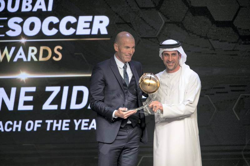 DUBAI, UNITED ARAB EMIRATES - DEC 28, 2017.   Zinedine Zidane receives Best Coach of the Year Award from Abdullah Khalifa Al Merri during the Globe Soccer Awards 2017.  (Photo by Reem Mohammed/The National)  Reporter:   Section: SP