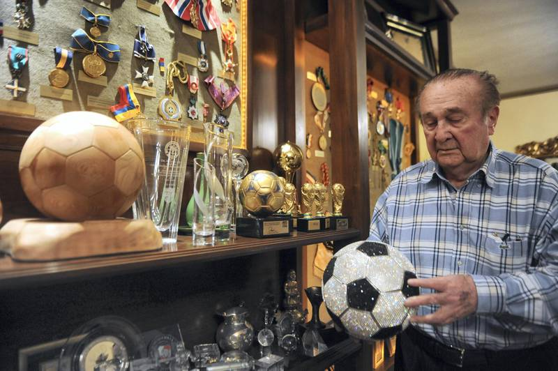 TO GO WITH AFP STORY BY HUGO RUIZ Former Conmebol president Nicolas Leoz shows trophies and medals he received during his period as president during an interview at his residence in Asuncion on June 13, 2013. Leoz admitted having received USD 130,000 from the ISMM/ISL group for the television rights in the 90s', money that he said it was employed to build four schools for native children. AFP PHOTO Norberto Duarte (Photo by NORBERTO DUARTE / AFP)