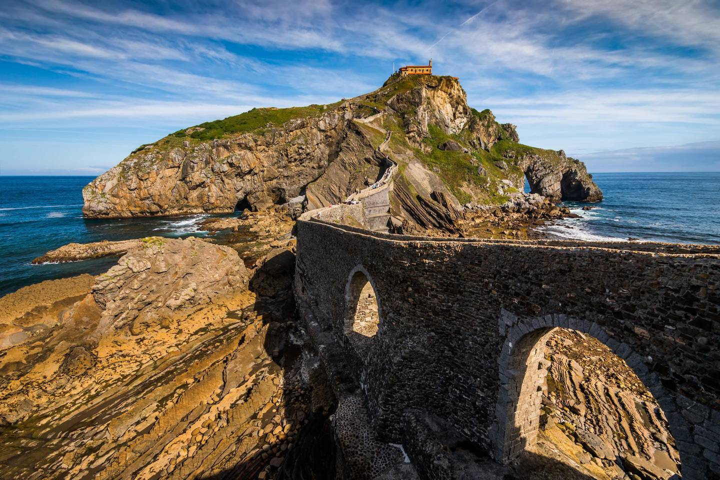 San Juan de Gaztelugatxe at sunset in Basque Country, Spain. On top of the island stands a little hermitage. Getty Images