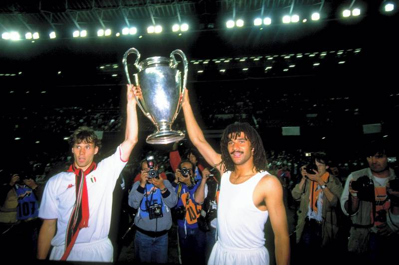 24 May 1989:  Marco Van Basten (left) and Ruud Gullit (right) of AC Milan celebrate with the trophy after winning the European Cup Final match against Steaua Bucuresti at Nou Camp in Barcelona, Spain. AC Milan won the match 4-0. \ Mandatory Credit: SimonBruty/Allsport