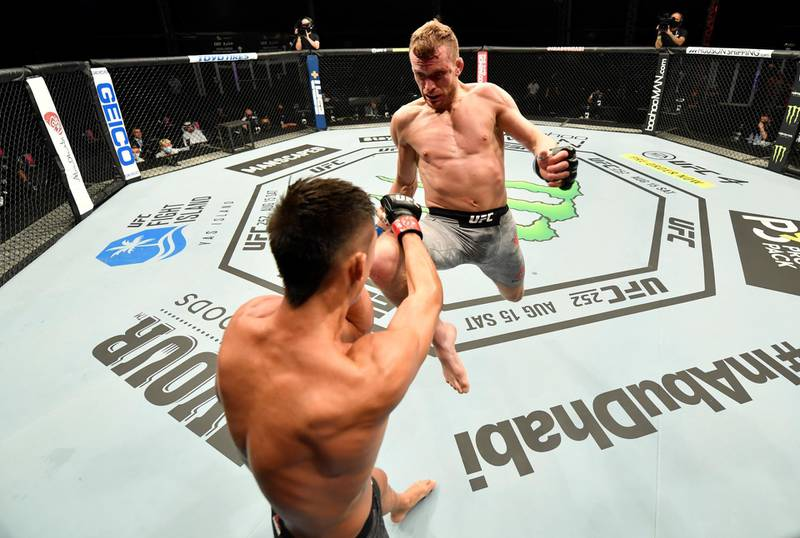 ABU DHABI, UNITED ARAB EMIRATES - JULY 12: (R-L) Davey Grant of England launches a flying knee against Martin Day in their bantamweight fight during the UFC 251 event at Flash Forum on UFC Fight Island on July 12, 2020 on Yas Island, Abu Dhabi, United Arab Emirates. (Photo by Jeff Bottari/Zuffa LLC)