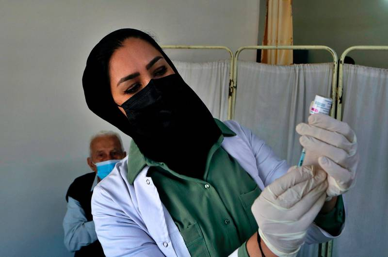 An Iraqi nurse prepares a shot of the AstraZeneca COVID-19 vaccine at a clinic in Baghdad, Iraq, Sunday, March 28, 2021. (AP Photo/Khalid Mohammed)