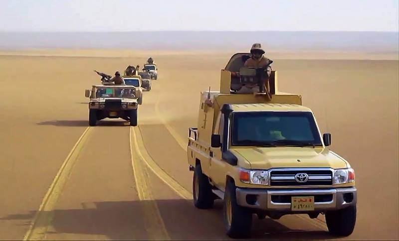 """An image grab taken from a handout video released by the official Facebook page of Egypt's Military Spokesman on December 8, 2020 shows an Egyptian army pickup trucks and humvees (High Mobility Multipurpose Wheeled Vehicles - HMMWVs) driving in the desert. Residents of Egypt's restive North Sinai region ran for their lives when an Islamic State group affiliate occupied their villages. Now, they are returning to find their homes booby-trapped. The IED attacks that have multiplied in the vast, remote and sparsely populated region which authorities have declared off-limits to journalists recall those the IS launched to sow terror in Iraq and Syria. - RESTRICTED TO EDITORIAL USE - MANDATORY CREDIT """"AFP PHOTO / EGYPTIAN DEFENCE MINISTRY"""" - NO MARKETING NO ADVERTISING CAMPAIGNS - DISTRIBUTED AS A SERVICE TO CLIENTS    / AFP / EGYPTIAN DEFENCE MINISTRY / - / RESTRICTED TO EDITORIAL USE - MANDATORY CREDIT """"AFP PHOTO / EGYPTIAN DEFENCE MINISTRY"""" - NO MARKETING NO ADVERTISING CAMPAIGNS - DISTRIBUTED AS A SERVICE TO CLIENTS"""