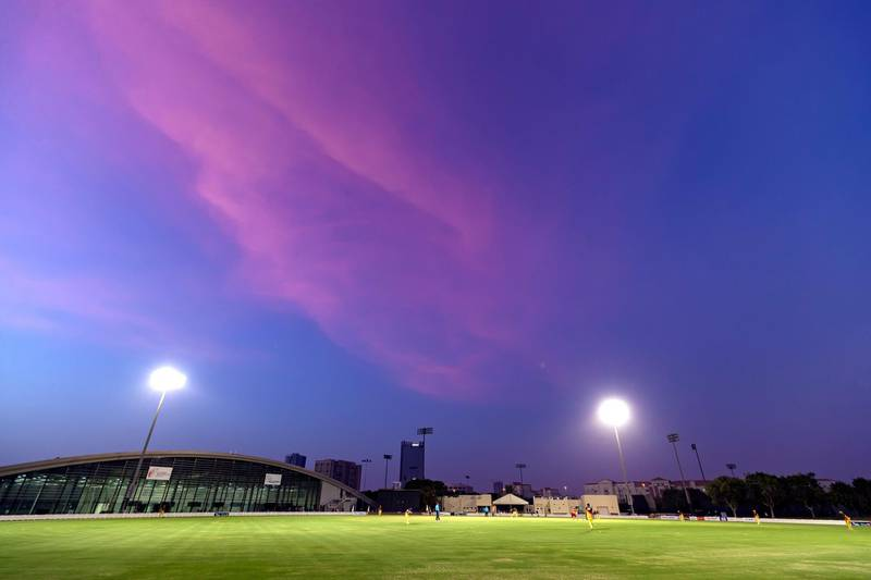 Dubai, United Arab Emirates - Reporter: N/A. Sport. Cricket. Purple sky over the ICC academy during the game between Abu Dhabi and Ajman in the Emirates D10. Friday, July 24th, 2020. Dubai. Chris Whiteoak / The National