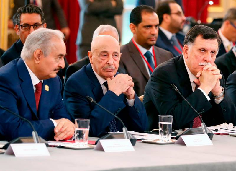 (FILES) In this file photo taken on May 29, 2018 (L to R) Libyan strongman Khalifa Haftar,  speaker of the eastern-based parliament Aguila Saleh Issa, and head of the Tripoli-based UN-recognised unity government Fayez al-Sarraj, attend an International Congress on Libya at the Elysee Palace in Paris. Libya's warring rival governments announced in separate statements signed by Sarraj, Saleh and Haftar on August 21, that they would cease all hostilities and organise nationwide elections soon, an understanding swiftly welcomed by the United Nations.  / AFP / POOL / Etienne LAURENT