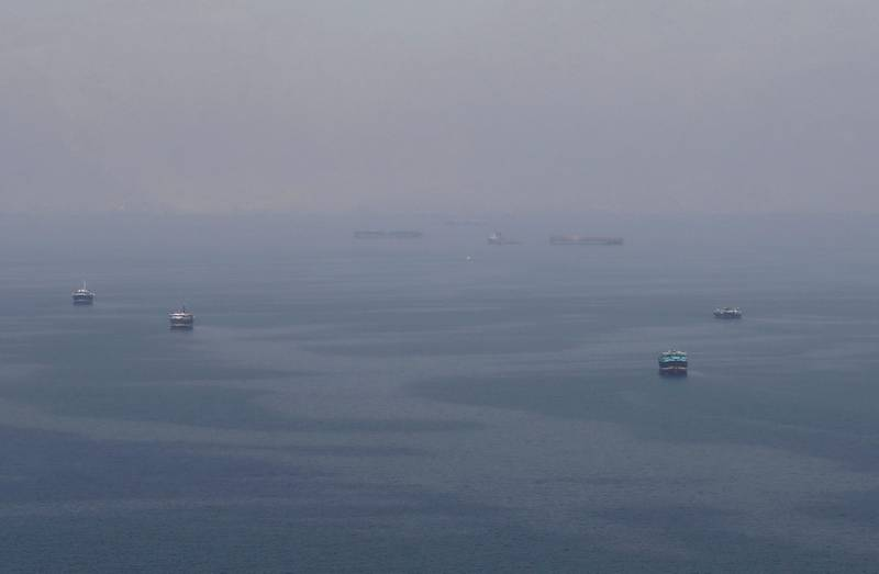 Traditional Omani boats known as dhows, and cargo ships are seen sailing towards the Strait of Hormuz, off the coast of Musandam province, Oman, July 21, 2018. Picture taken July 21, 2018. REUTERS/Hamad I Mohammed