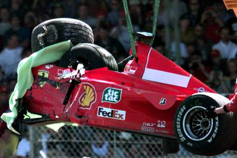 FILE - The July 11, 1999 file photo shows the damaged Ferrari of Germany's Michael Schumacher is lifted onto a flat bed truck, after he crashed into a tire wall on the first lap at Stowe corner, during the British Grand Prix at Silverstone, England. Michael Schumacher said Tuesday, Aug. 11, 2009 he is calling off his much-anticipated Formula One comeback because of lingering injuries from a motorcycling crash earlier this year. The seven-time world champion was to fill in for injured Ferrari driver Felipe Massa and hoped to return at the European Grand Prix in Valencia, Spain, later this month. (AP Photo/Max Nash, file)