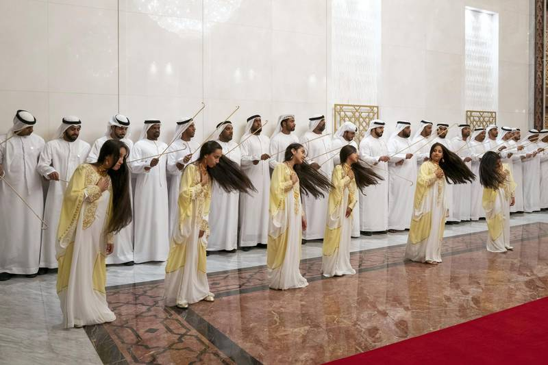ABU DHABI, UNITED ARAB EMIRATES - February 3, 2019: A traditional dance is performed upon the arrival of His Holiness Pope Francis, Head of the Catholic Church (not shown) and His Eminence Dr Ahmad Al Tayyeb, Grand Imam of the Al Azhar Al Sharif (not shown), at the Presidential Airport. ( Mohamed Al Hammadi / Ministry of Presidential Affairs ) ---