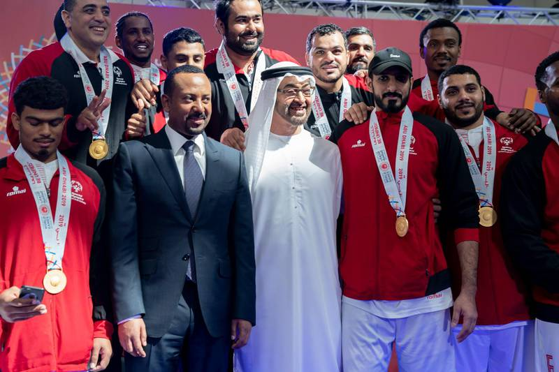 ABU DHABI, UNITED ARAB EMIRATES - March 20, 2019: HH Sheikh Mohamed bin Zayed Al Nahyan, Crown Prince of Abu Dhabi and Deputy Supreme Commander of the UAE Armed Forces (3rd L) with HE Abiy Ahmed, Prime Minister of Ethiopia (2nd L) stand for a photograph with Special Olympics World Games Abu Dhabi 2019 athletes at Abu Dhabi National Exhibition Centre.   ( Mohamed Al Hammadi / Ministry of Presidential Affairs ) ---