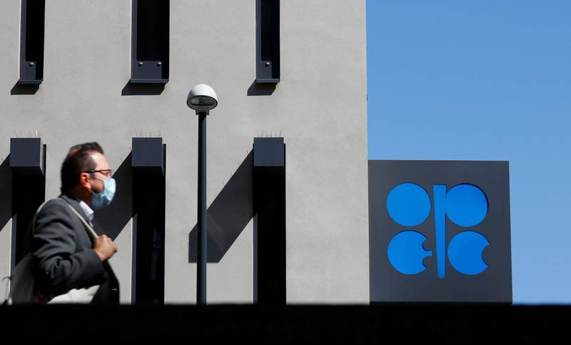A person passes the logo of the Organization of the Petroleoum Exporting Countries (OPEC) in front of OPEC's headquarters in Vienna, Austria April 9, 2020.  REUTERS/Leonhard Foeger