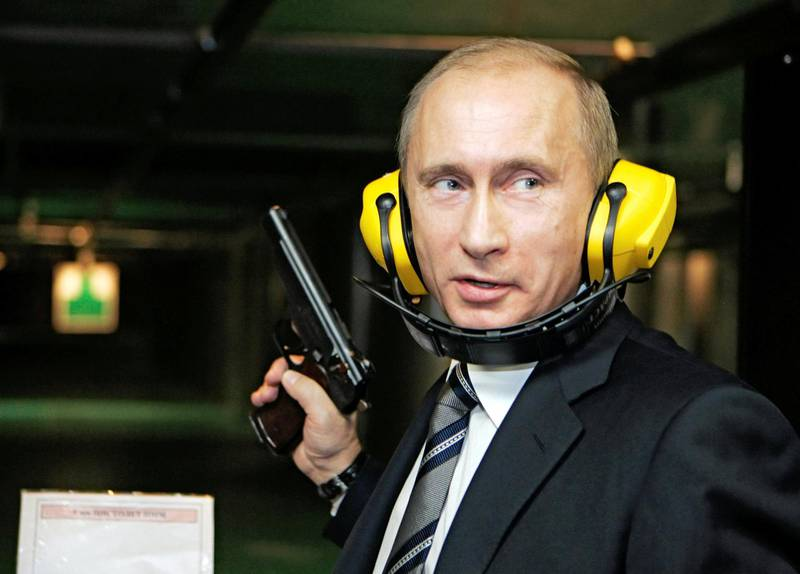 FILE PHOTO: Russian President Vladimir Putin stands with a gun at a shooting gallery of the new GRU military intelligence headquarters building as he visits it in Moscow November 8, 2006. REUTERS/ITAR-TASS/PRESIDENTIAL PRESS SERVICE (RUSSIA) - ATTENTION EDITORS - EDITORIAL USE ONLY/File Photo