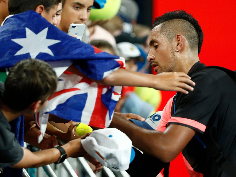 Tennis - Australian Open - Hisense Arena, Melbourne, Australia, January 17, 2018. Nick Kyrgios of Australia signs autographs after winning against Viktor Troicki of Serbia. REUTERS/Thomas Peter