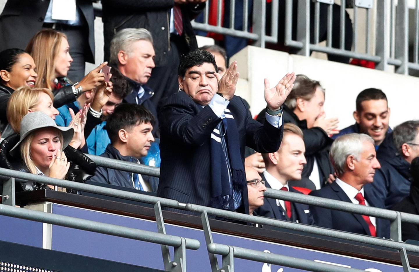 """Soccer Football - Premier League - Tottenham Hotspur vs Liverpool - Wembley Stadium, London, Britain - October 22, 2017   Diego Maradona applauds after Tottenham's Harry Kane scores their first goal    Action Images via Reuters/Matthew Childs    EDITORIAL USE ONLY. No use with unauthorized audio, video, data, fixture lists, club/league logos or """"live"""" services. Online in-match use limited to 75 images, no video emulation. No use in betting, games or single club/league/player publications. Please contact your account representative for further details."""