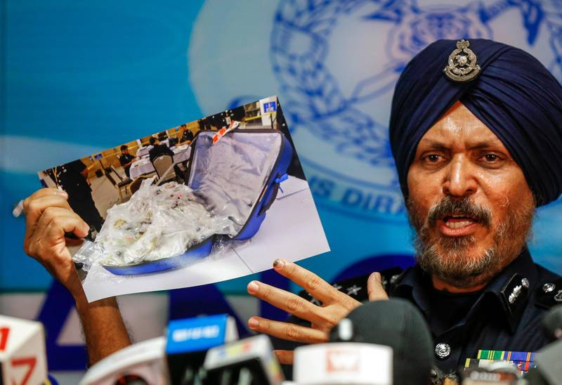 epa06843211 Malaysian Police's Commercial Crime Investigation Department (CCID) Director, Amar Singh shows a photograph of seized items from a raid at the residence of former Malaysian prime minister Najib Razak during a press conference in Kuala Lumpur, Malaysia, 27 June 2018.  EPA/AHMAD YUSNI