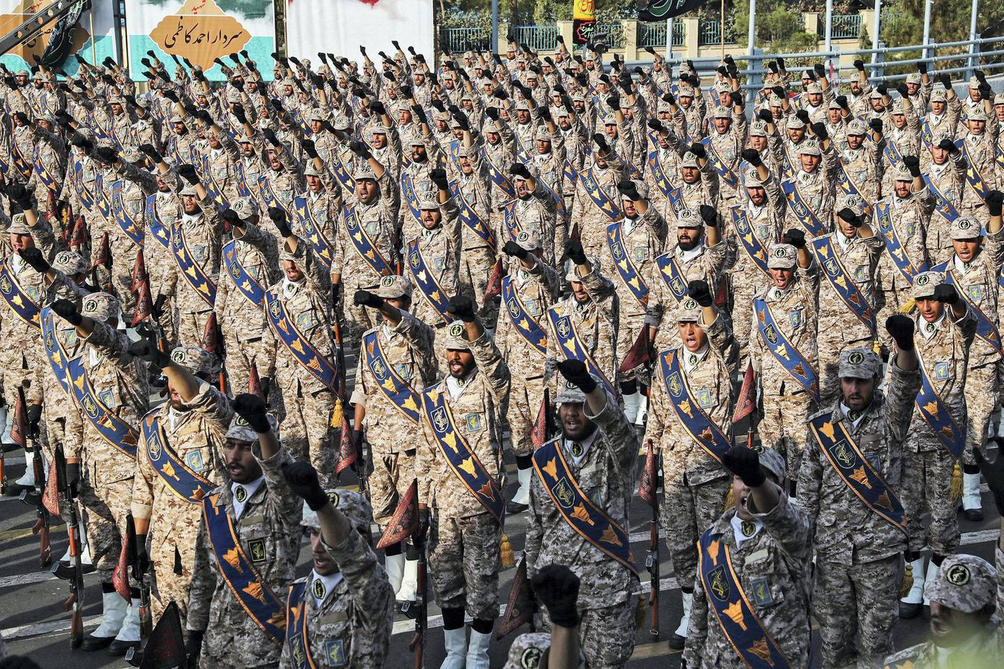 """A handout picture provided by the Iranian presidency on September 22, 2019 shows members of Iran's Islamic Revolutionary Guard Corps (IRGC) giving a military salute during the annual """"Sacred Defence Week"""" military parade marking the anniversary of the outbreak of the devastating 1980-1988 war with Saddam Hussein's Iraq, in the capital Tehran. - Rouhani said on September 22 that the presence of foreign forces creates """"insecurity"""" in the Gulf, after the US ordered the deployment of more troops to the region. """"Foreign forces can cause problems and insecurity for our people and for our region,"""" Rouhani said in a televised speech at the annual military parade, adding that Iran would present to the UN a regional cooperation plan for peace. (Photo by - / Iranian Presidency / AFP) / === RESTRICTED TO EDITORIAL USE - MANDATORY CREDIT """"AFP PHOTO / HO / IRANIAN PRESIDENCY"""" - NO MARKETING NO ADVERTISING CAMPAIGNS - DISTRIBUTED AS A SERVICE TO CLIENTS ==="""